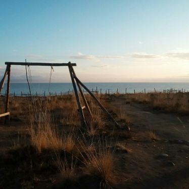 Schaukel Issyk Kul Sonnenaufgang Kirgistan