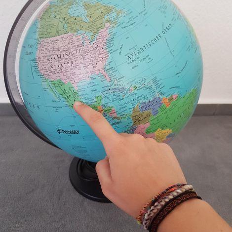 Globus mit Zeiger auf Mexiko