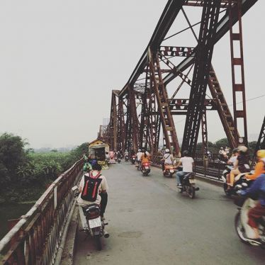 Crossing the Red River, walking on the famous Long Bien bridge ... and having…