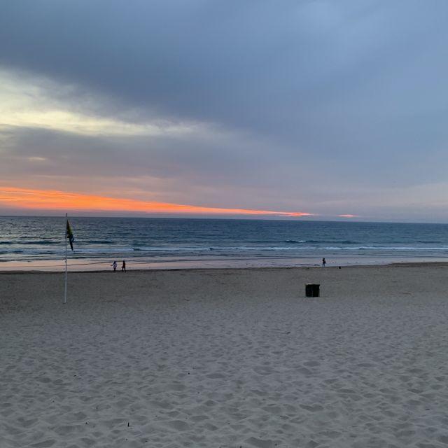 Sonnenuntergang am Strand von Caparica, Lissabon
