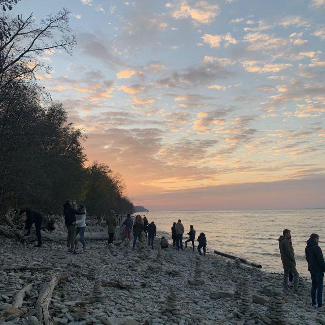 Foto eines Sonnenuntergangs mit Freunden